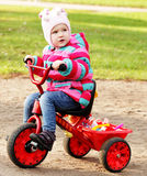 Little girl on a bicycle. Portrait of a little girl on a bicycle in autumn  park outdoors Stock Photo