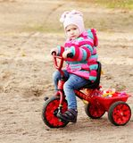 Little girl on a bicycle Stock Photo