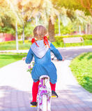 Little girl on the bicycle Royalty Free Stock Photos