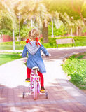 Little girl on the bicycle Royalty Free Stock Images
