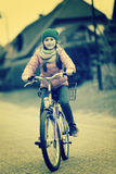 Little girl with bicycle on road.Retro image Stock Image