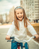Little girl on a bicycle Royalty Free Stock Photos