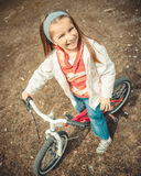 Little girl on a bicycle Stock Image
