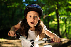 Little girl with bicycle in summer park outdoors Royalty Free Stock Photos