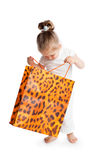 Little girl with big bag Stock Images