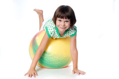 Little girl on a big ball Royalty Free Stock Photos