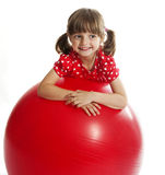 Little girl and big ball Stock Photo