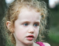 A Little Girl with Big Blue Eyes Stock Photo