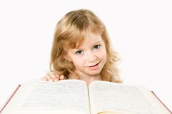 Little girl with a big book isolated on white Stock Photography