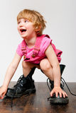 Little girl in big boots Stock Photography