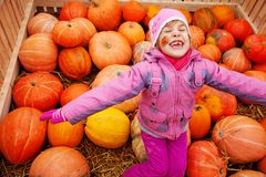 Little girl in big box with pumpkins Royalty Free Stock Images