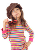 Little girl in big brown hat and with sunglasses Royalty Free Stock Images