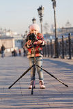 Little girl with the big camera Stock Image
