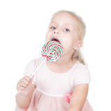 Little girl with a big candy Stock Image