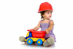 Little girl with a big car Royalty Free Stock Images