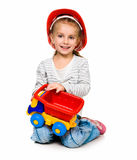 Little girl with a big car Stock Photography