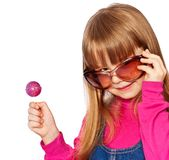 Little girl in big dark glasses and lollipop. Close up Stock Images