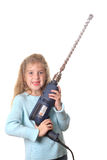 Little girl with big drill Royalty Free Stock Photography