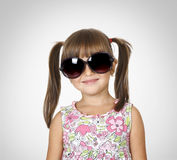 Little girl in big glasses. Portrait of smilling little girl in big glasses Royalty Free Stock Photos