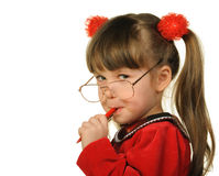 The little girl in big glasses and with pen stock image