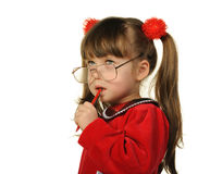 The little girl in big glasses and with pen Royalty Free Stock Image