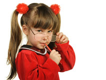 The little girl in big glasses and with pen Royalty Free Stock Images