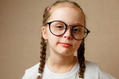 little girl with big glasses royalty free stock photography