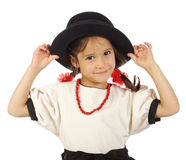Little girl with big hat and red beads Stock Images