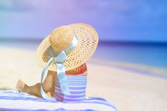 Little girl in big hat on summer beach Stock Photography
