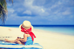 Little girl in big hat on summer beach Royalty Free Stock Images