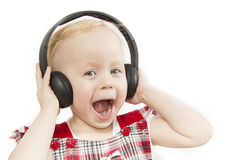 Little girl in big headphones. On white background Royalty Free Stock Photo