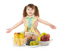 Little girl with big heap of different fruits Royalty Free Stock Images