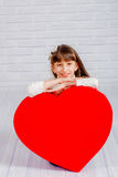 Little girl with a big heart Stock Photography