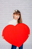 Little girl with a big heart Royalty Free Stock Photography