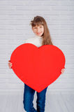 Little girl with a big heart Royalty Free Stock Images