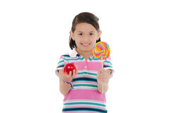 Little girl and big lollipop with apple Royalty Free Stock Photo
