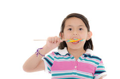Little girl and big lollipop Royalty Free Stock Image