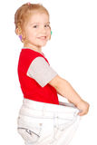 Little girl in big pants Royalty Free Stock Image