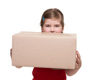 Little girl with big parcel box Stock Images