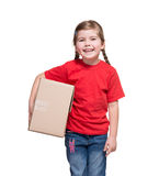 Little girl with big parcel box Stock Image