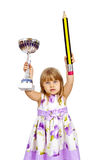 Little girl with big pencil and sport cup Royalty Free Stock Image