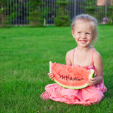 Little girl with big piece of watermelon in hands Royalty Free Stock Photo