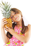 Little girl with big pineapple. Little girl posing with big pineapple Stock Photography
