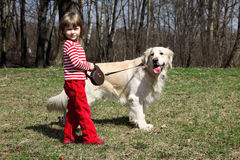 Little girl with big retriever outdoors Royalty Free Stock Photos