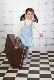Little girl with the big road suitcase Royalty Free Stock Photography