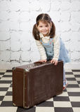 Little girl with the big road suitcase Royalty Free Stock Photos