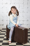 Little girl with the big road suitcase Stock Photo