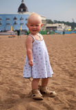 Little girl and big sandals Royalty Free Stock Image