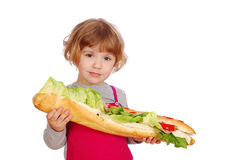 Little girl with big sandwich Royalty Free Stock Photo