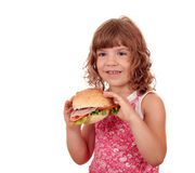 Little girl with big sandwich on white Royalty Free Stock Images
